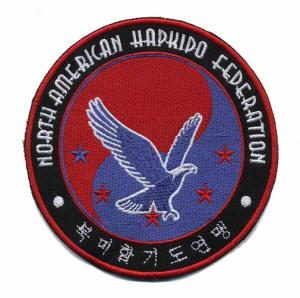 China 2012 fashion custom embroidery patches with heat cut border heat seal backing on sale