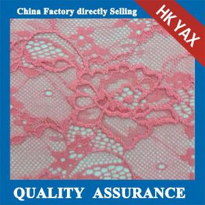 China 2014 china factory cheap hot selling beautiful pink elastic lace fabric/stretch lace fabric in little flower pattern on sale