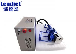 China Mini Handheld Fiber Laser Batch Coding Machine Compact Design For Rubber Pipe on sale
