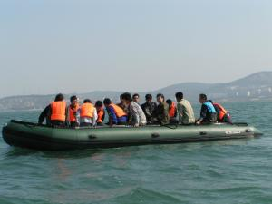 China Black Inflatable Sport Boat PVC / Hypalon Handmade Ferry Boat With High Capacity on sale