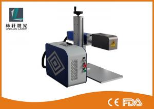 China Table Type Metal Laser Marking Machine Reliable With Safe Fullcolsed Cabinet on sale