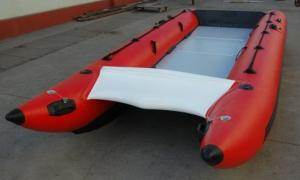 China Red Hand Crafted High Speed Inflatable Boats Racing Catamaran Boat With 450cm Length on sale