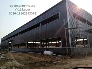 China Large Size Steel Structure Warehouse Prefab Steel Warehouse SA 2.5 Shot Blasting Grade on sale