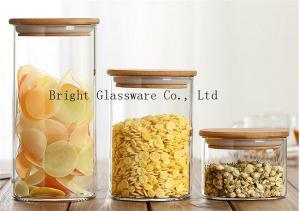 China 木のふたの販売の膨らんだ高いホウケイ酸ガラスの貯蔵の瓶 on sale