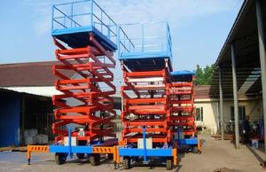 China Movable Four Wheels Hydraulic Lift Platform , Aerial Platform Lift Diesel Engine Powered on sale