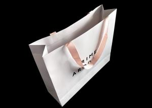 China Craft White Paper Shopping Bags UV Logo Printing With Ribbon Handle Paper Grocery Sacks on sale