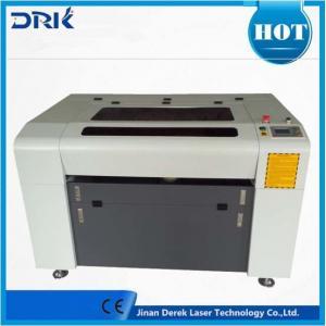 China machine de gravure de laser de commande numérique par ordinateur de couverture de téléphone de gravure de laser de bouteille en verre de vin de la découpeuse 3d on sale