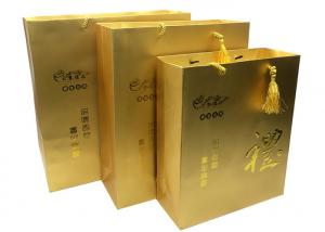 China Custom Printed Luxury Gold Paper Gift Bags Packaging with Embossed LOGO for Sale on sale