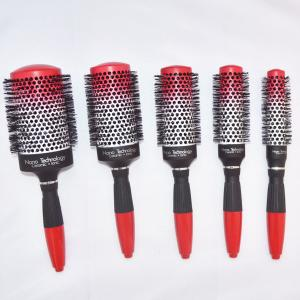 China Red Rubber Handle Round Hair Brush Combing the Hair in Any Direction without Tangling on sale