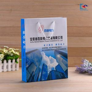 China Customs logo color printing art paper business gift paper bags Anniversary celebration paper bag on sale