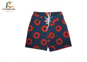 China Polyester Surf Boys Board Shorts Beachwear With Custom Logo Printing on sale