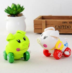China 5cm high Cheap Christmas toy for children white green wind up pig on sale