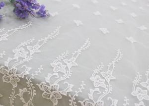 China Embroidered Edge Fabric White Floral Lace Vine Netting Tulle For Bridal Gowns on sale
