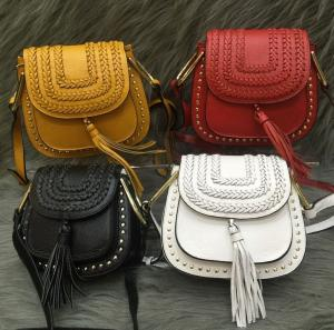 China Female head layer of leather 2016 new European and American fashion rivet fringed shoulder bag Messenger packet on sale