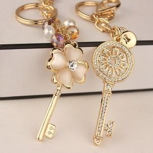China Exquisite metal rhinestone key shaped keychain on sale