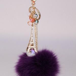 China High end eiffel tower keychian fur ball keychain gift use on sale