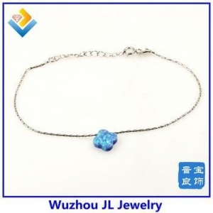China Sythetic 4C Flower Opal Bracelet Clover Shape Baby Blue Opal 925 Silver Bangle on sale