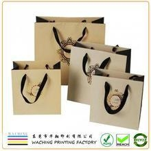 China High Quality Luxury Paper Gift Bags With Logo Print For Clothing on sale