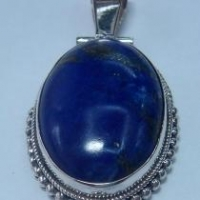Artisan crafted sterling lapis pendant balls work hinge on the bail.