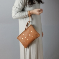 China Leather clutch with confetti gold dots on sale