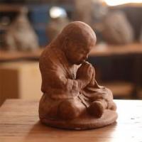 China Volcanic Ash Namaste Monk with Antique Finish on sale
