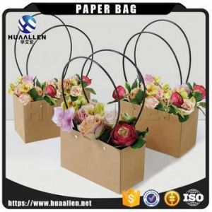 China China supplier offering Recyclable Flower gift packaging kraft paper carrier bag with long handles on sale