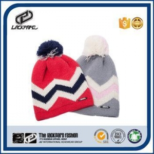 China Custom style elastic jacquard puffball winter hat boonie cloche cap on sale
