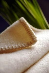 China Bedding Collections Plush Merino Wool Whip Stitched Baby Blanket - 100% Sustainable Wool on sale
