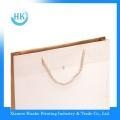 China Gloss lamination paper bag with handle on sale
