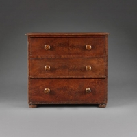 An early 19th century painted pine chest of drawers