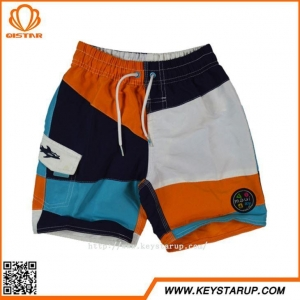 China Child Boardshorts Boys Light Weight Color Block Breathable Swim Shorts Manufacturers on sale