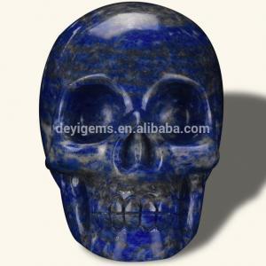China 2 Natural Carved Small Lapis Lazuli Jasper Skull Semi-precious Stone Crafts for Home Decor on sale