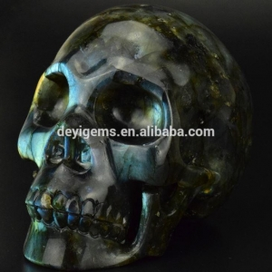 China Hot Sale Wholesale 5 Inch Crystal Craft Hand Carved Natural Labradorite Skull Halloween Skull Decor on sale