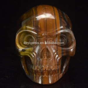 China Natural Hand Carved Yellow Tiger Eye Stone 4/6/10inch Carved Alien Skull Wholesale By Factory on sale