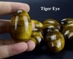 China Undrilled Wholesale Natural Tiger Eye Eggs Semi-precious Stone Jade Eggs Kegel Exercise on sale