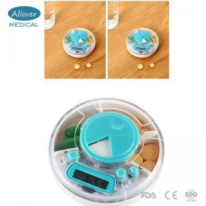 China Round Shape Medicine Electronic Pill Box Timer on sale