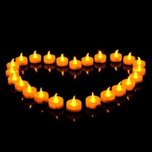 China Flameless Battery Operated Yellow Flickering Electric LED Tealight Candle for Church on sale
