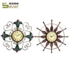 China Iron Wall Hanging Handcraft Decoration Artificial metal art wall clocks for sale
